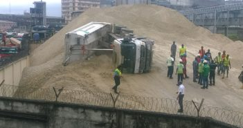 Two persons escape death as tipper falls while tipping sand in Apapa
